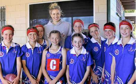 Warwick 12 years netballers Eliza Eastwell, Bronte LeSeuer, Claire Kelly, AJ Ryan, Diamonds star Laura Geitz, Hannah Duggan, Eliza McLennan, Kaitlin Wallace, Madison Burton and Lily Maw after winning the Darling Downs Inter-district competition.