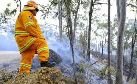 A Rural Fire Service volunteer watches over