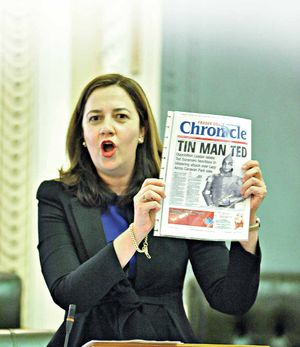 Leader of the Opposition Annastacia Palaszczuk held up the front page of the Fraser Coast Chronicle featuring 'Tin Man Ted' in parliament during an attack on the LNP.