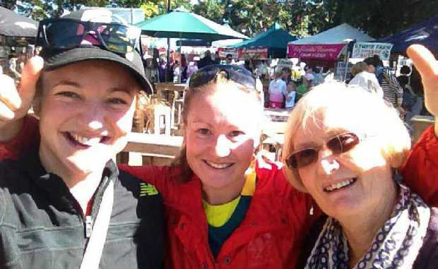 Caitlin (left) and Merilyn Willis ( right) enjoy some time with their favourite Olympian , Benita (centre) in Brisbane.