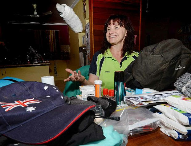 MOUNTAIN CHALLENGE: Karen McIntyre prepares to leave for Africa.