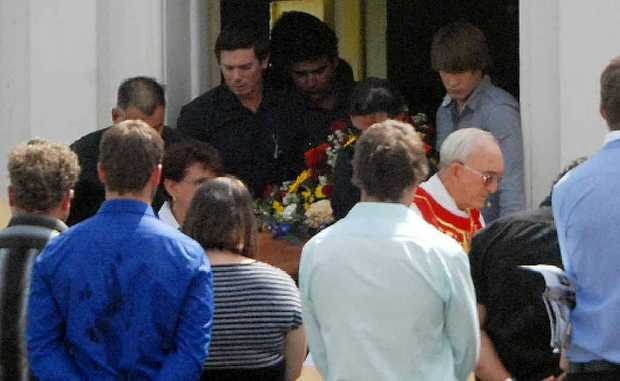 Pallbearers leave the Holy Rosary Catholic Church at Marian yesterday at the funeral of 21-year-old Anthony Bezzina.