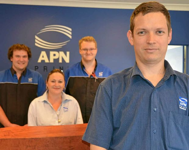(from left) APN Print pre-press apprentice Nick Crouch, administration officer Donna Lindner, folding apprentice Mitch Weeks and pre-press employee David Mulliss.