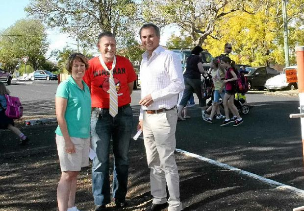 Principal of Grafton Public School, Will Randall, centre, and the secretary of the school's P&C; Association, Rebecca Stanmore with Chris Gulaptis outside the infants campus in Mary St where the flashing lights will be installed. Mr Randall is dressed for the school's Westpac Rescue Helicopter fundraising day.