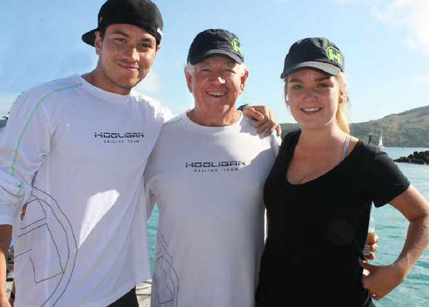 Marcus Blackmore celebrates the win with his children, Aly and Imogen at Hamilton Island yesterday.