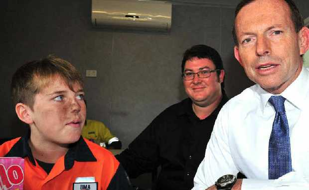 Joshua Howlett, a 15-year-old work experience student, meets Federal Opposition Leader Tony Abbott and Member for Mackay George Christensen at GDH Engineering yesterday.