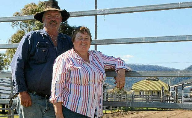 HARD WORKIN': Ross and Jan Hamilton prepare Killarney Showgrounds ahead of this weekend's competition.