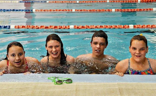 Mackay swimmers Kylie Duncan, Nicole Froling, Ray Bornman and Jorgia Powell take a break from training in the pool following the Queensland titles.