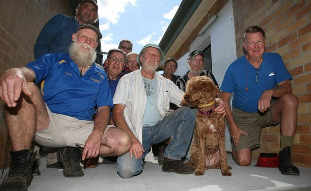Murwillumbah Men's Shed members admire the new concrete slab they are working on.
