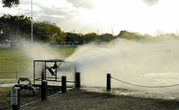 Water sprays onto Ellem Oval after a gasket on a flanged plate in the oval's irrigation system gave way on Monday afternoon.