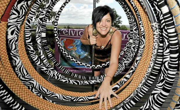 Lara Eardley, of Lennox Head, uses her handmade hula hoops to help women improve their pelvic floor strength an increase their flow of primal energy.