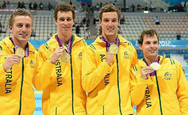 Gold medallists Matthew Cowdrey, Andrew Pasterfield, Blake Cochrane and Matthew Levy on the podium during the medal ceremony for the men's 4x100m freestyle relay.