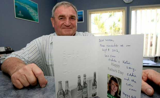 Warren Polgalse with his Father's Day card which says it's from Katie Milne, but she denies it.