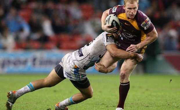 Peter Wallace of the Broncos is tackled during the round 19 NRL match between the Brisbane Broncos and the Gold Coast Titans at Suncorp Stadium on July 15, 2011 in Brisbane, Australia.
