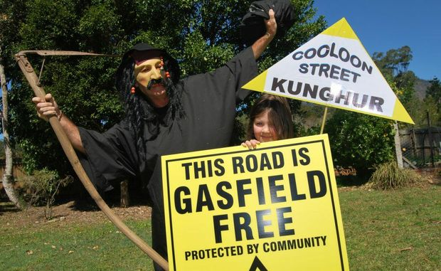 Tweed Valley resident Audrey O'Donnell with the coal-seam gas threat, as depicted by the Grim Reaper, at Mount Burrell.