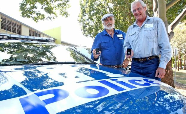 Former NSW Police officers Mahendra Blackman and Ramon Blanchard with their commemorative medals.