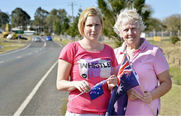 Belinda Woodward and Bev Draper waited as the bodies of three fallen soldiers passed by.