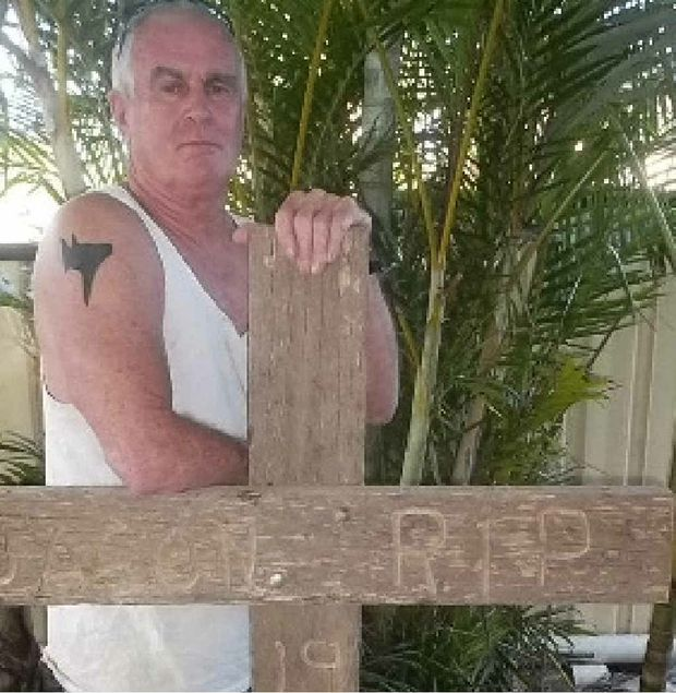 Peter Johnson, of Iluka, with his Black Dog tattoo and a memorial to his son, Jason.