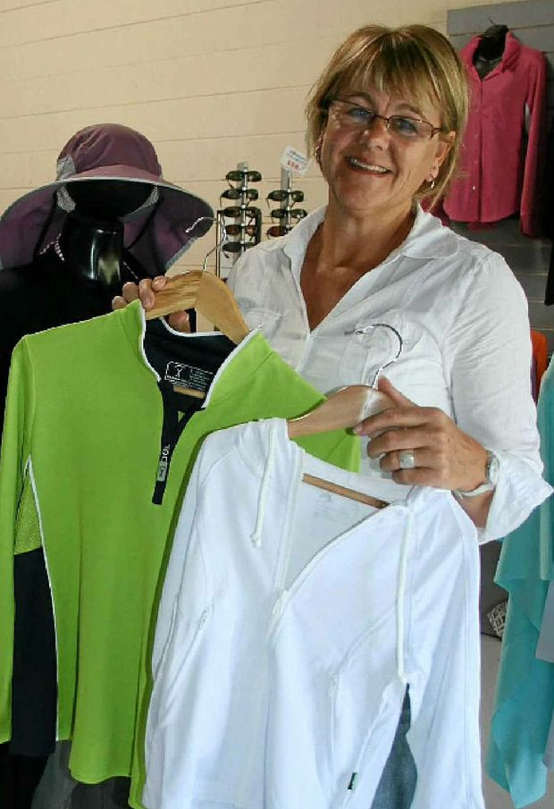 PROTECT YOURSELF: Kerryn Meanwell from SunProtection Australia shows off some of the sun-safe clothes designed by her business.