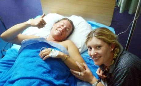 Shark attack victim Kylie Maguire in hospital in Tonga with friend Kim Hands. Her family is organising a flight to a Sydney hospital.