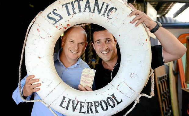 Don Fenwick and David Stringer, photographed at Chinderah Bay Antiques Museum, have bought blueprints for the new Titanic ship from Clive Palmer. They were purchased at an auction that raised close to $20,000 for the Greenmount Surf Life Saving Club.