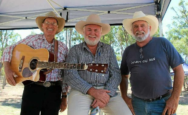 Graham Parfitt, Merv West and Peter Driscoll waiting to take to the stage at the Bony Mountain Music Festival yesterday.
