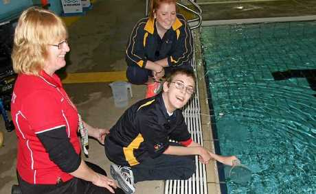 Zak Sorenson doing a water test with WIRAC staff member Carla Frizzell as part of his duties during work experience at WIRAC.