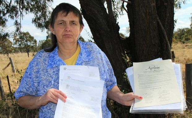 NOT FORGOTTEN: Rhonda Trivett holding letters from the Government which never heal the scars she carries from being a minor in Wolston Park Hospital. Photo: Rose Hamilton-Barr