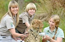 Australia Zoo's Africa exhibit is celebrating its first birthday this week. Terri, Bindi and Robert Irwin take time out to feed William the Cheetah.