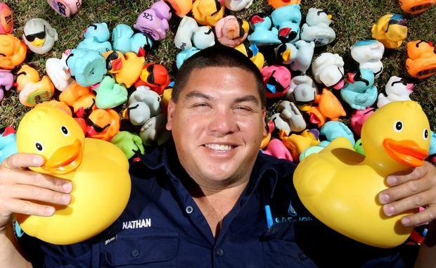 Nathan Williams with some of the competitors who will take part in the inaugural duck race at Cudgen Creek.