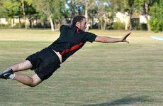 Matt Lombardozzi demonstrates a layout as he gets fit playing ultimate frisbee. Matt and partner Stephanie Updike are keen to find more players for the unusual new sport.