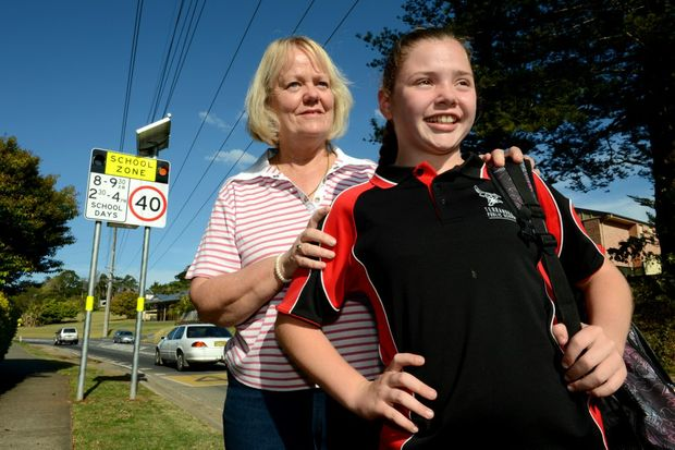 Carla and Tianne Turrall at Terranora Public School, near the school zone lights that have already made a noticeable difference.