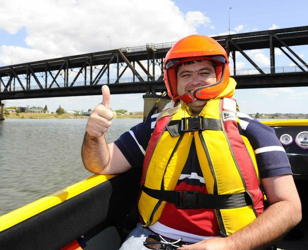 Clarence Valley Councillor Richie Williamson gives the thumbs up before being taken for a run by Jason Disson in his boat Bazinga on the Clarence River on Saturday.
