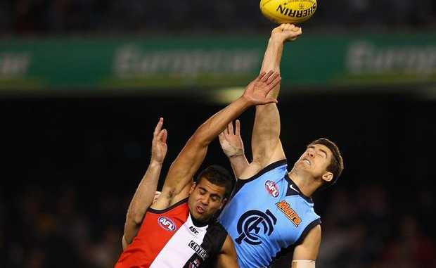 Jordan Russell of the Blues spoils a mark by Ahmed Saad of the Saints during the round seven AFL match between the St Kilda Saints and the Carlton Blues at Etihad Stadium.
