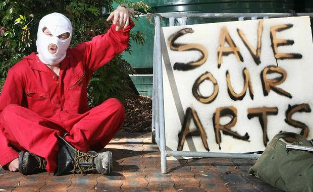 Rodney Laukens protests at Bremer Institute of Tafe yesterday at the cutting of art programs at the centre.