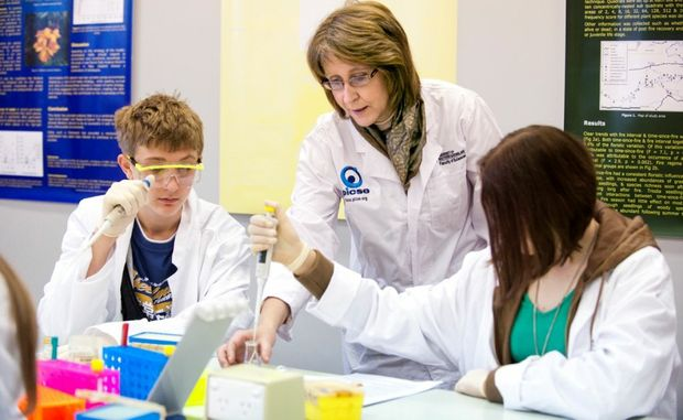 Academic Liaison Officer for the Faculty of Sciences Kay Lembo puts some students through their paces at last year's USQ Science Experience.