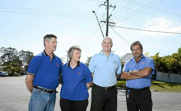 John and Delmae Haydon of Iluka Quality Meats, Ron Taylor of Iluka Pharmacy and Jeff Mackenzie of Foodworks celebrate a win over Essential Energy who wanted to turn off power on a weekday in their street.