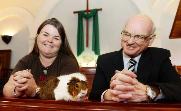 Chilli Pepper and her owner Rachel Sipple, president of Summerland Cavy Club with Rev John Thornton.