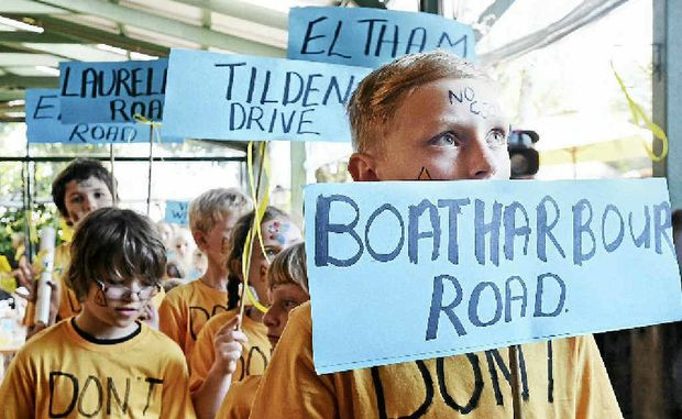 Jake McNab (front) of Eltham with other children from the local area holding signs depicting local streets they want CSG free.