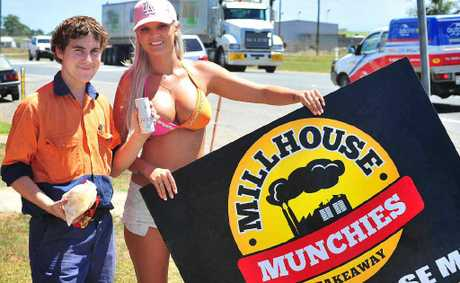 LOOK TWICE: Mill worker Chris Formosa with promotions girl Kirby Keegan outside Millhouse Munchies on Peak Downs Hwy.
