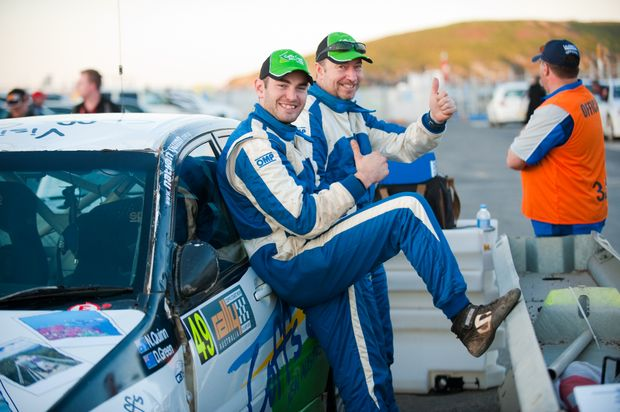 Coffs Coast Rally Team's Nathan Quinn and David Green salute the crowd at last year's Rally Australia.