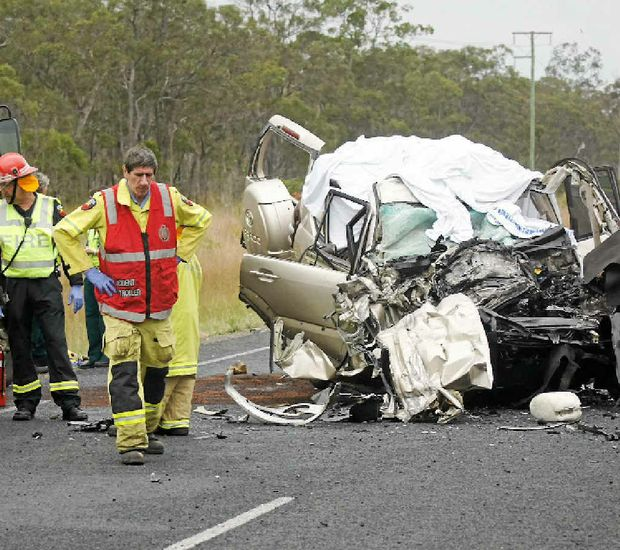 Childers fire captain Curl Santacaterina takes a moment at the scene of Sunday's crash on the Bruce Hwy near Pig Creek, in which five people died.