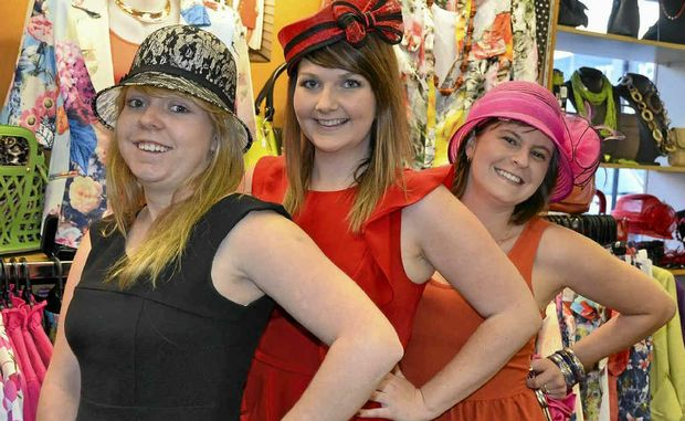 Katrina Bennett, Emily Hetherington and Kate Delany don some racing hats from Classic Dimensions in preparation for this year's Warwick Cup meeting on October 13.