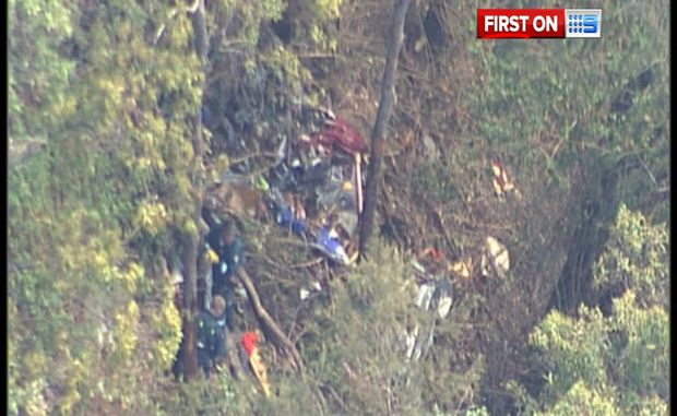 AGL rescue crew at the scene of the plane wreckage near Imbil. There were no survivors.