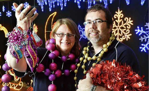 TINSEL TRADE: Christmas Shack owners Garry and Corrine McEwan unpack a shopful of festive trimmings.