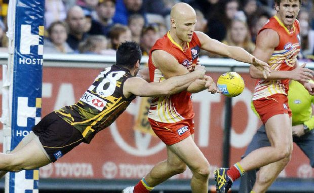 ACTION PACKED: Paul Puopolo of Hawthorn and Gary Ablett of The Gold Coast Suns in action during their Round 21 AFL game at the MCG in Melbourne.