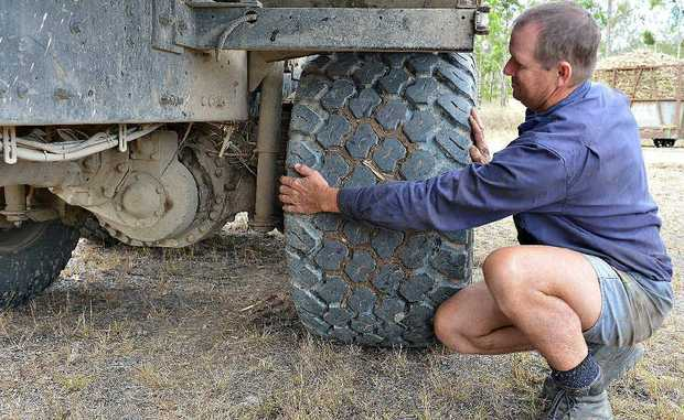 Comsin Harvesting owner Stephen Comelli with one of the new tyres he is using on some of his haul-out machinery. The tyres tread more lightly on farmers' paddocks and are better for the environment.