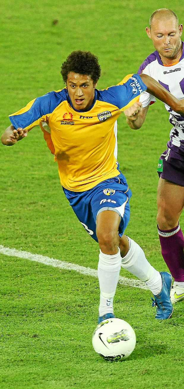 Mitch Cooper takes on the Perth Glory defence for Gold Coast United in round 24 last season.