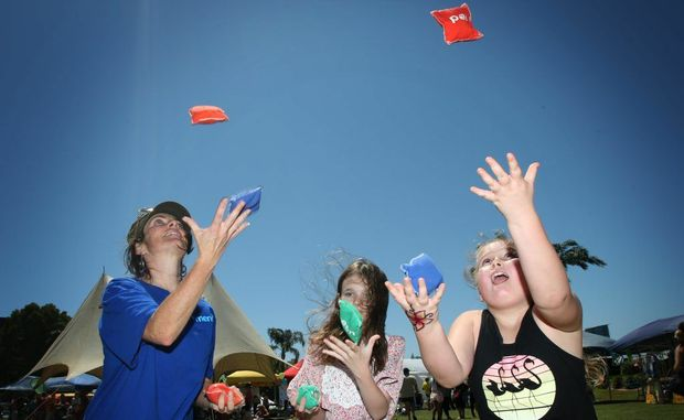 Family Day at Jack Evans Boat Harbour- Lowey Eldrick, Faith Noble nad Zahli Woods practice some juggling Photo Blainey Woodham / Daily News