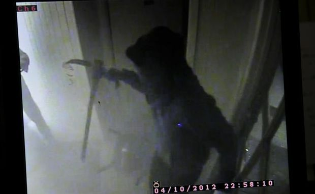 The armed bandit who held-up a hotel at Withcott captured on CCTV.